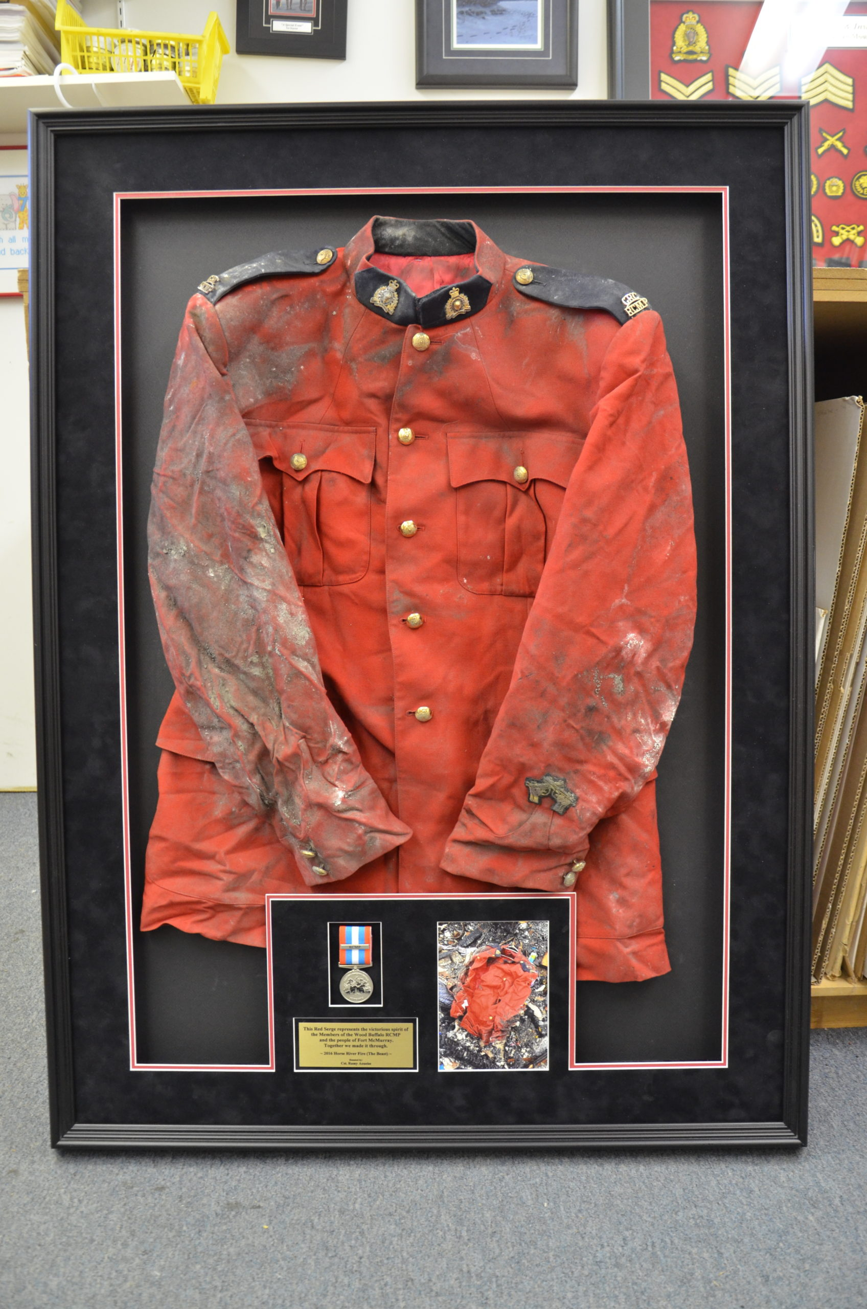 Wildfire Surviving Red Serge Framed by Wood Buffalo RCMP