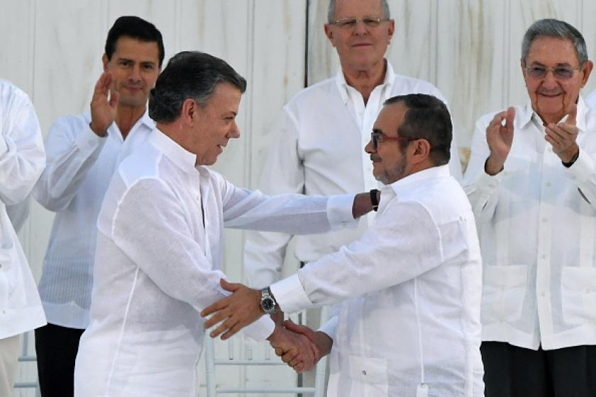 Colombia and FARC sign historic pact ending 52-year war