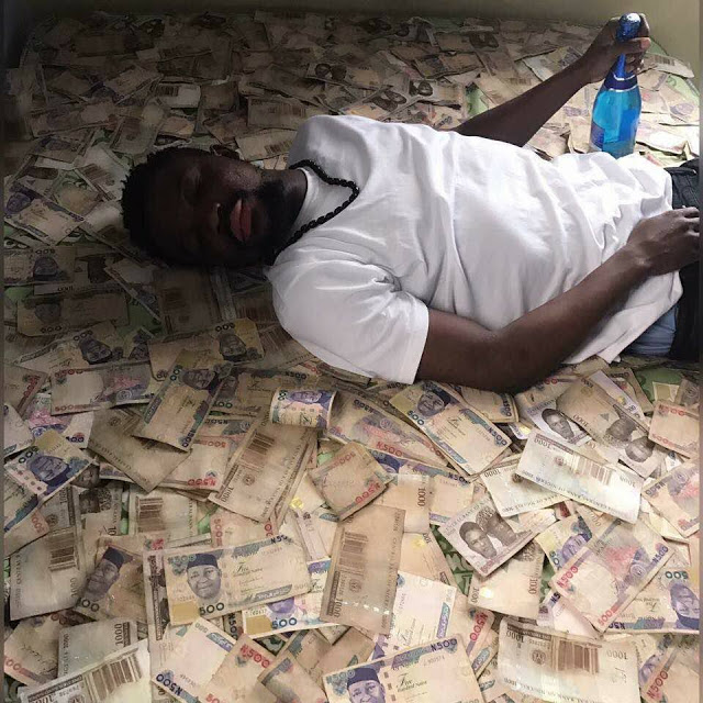 Nigerian boy who sleeps on stacks of money announces search for a baby mama