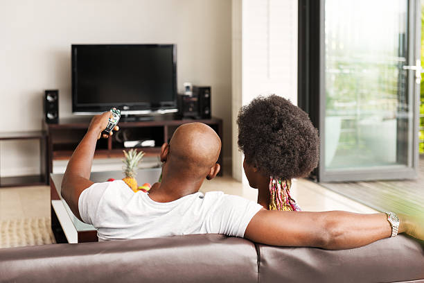 Black man watching tv images for People watching