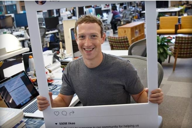 Mark Zuckerberg tapes up his webcam