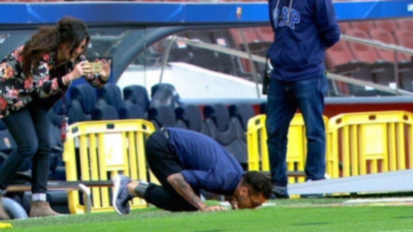 Dani Alves Returns To The Nou Camp By Kissing The Turf