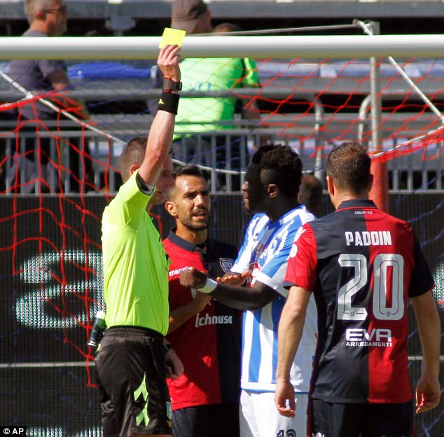 Sulley Muntari booked after reporting racist abuse to referee during Serie A game