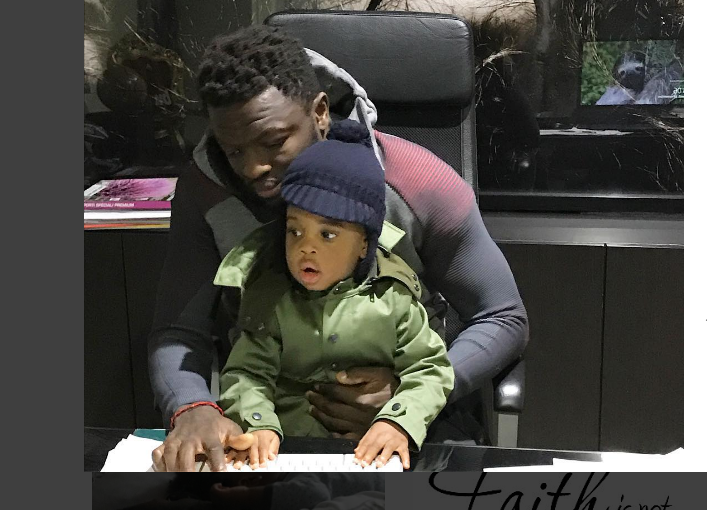 PHOTO: Sulley Muntari spends time with son in his office