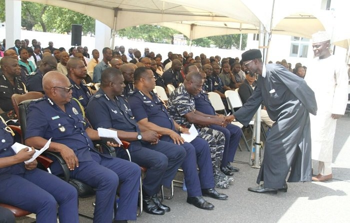 Police personnel pray for peaceful election