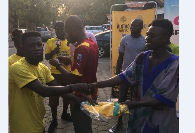 Scores of soccer fans join Alomo Bitters EPL activation train