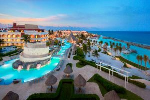 hard_rock_hotel_riviera_maya_signature-hacienda-pool-at-dusk