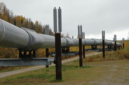 Kinder Morgan pushes for pipeline despite lack of permits.