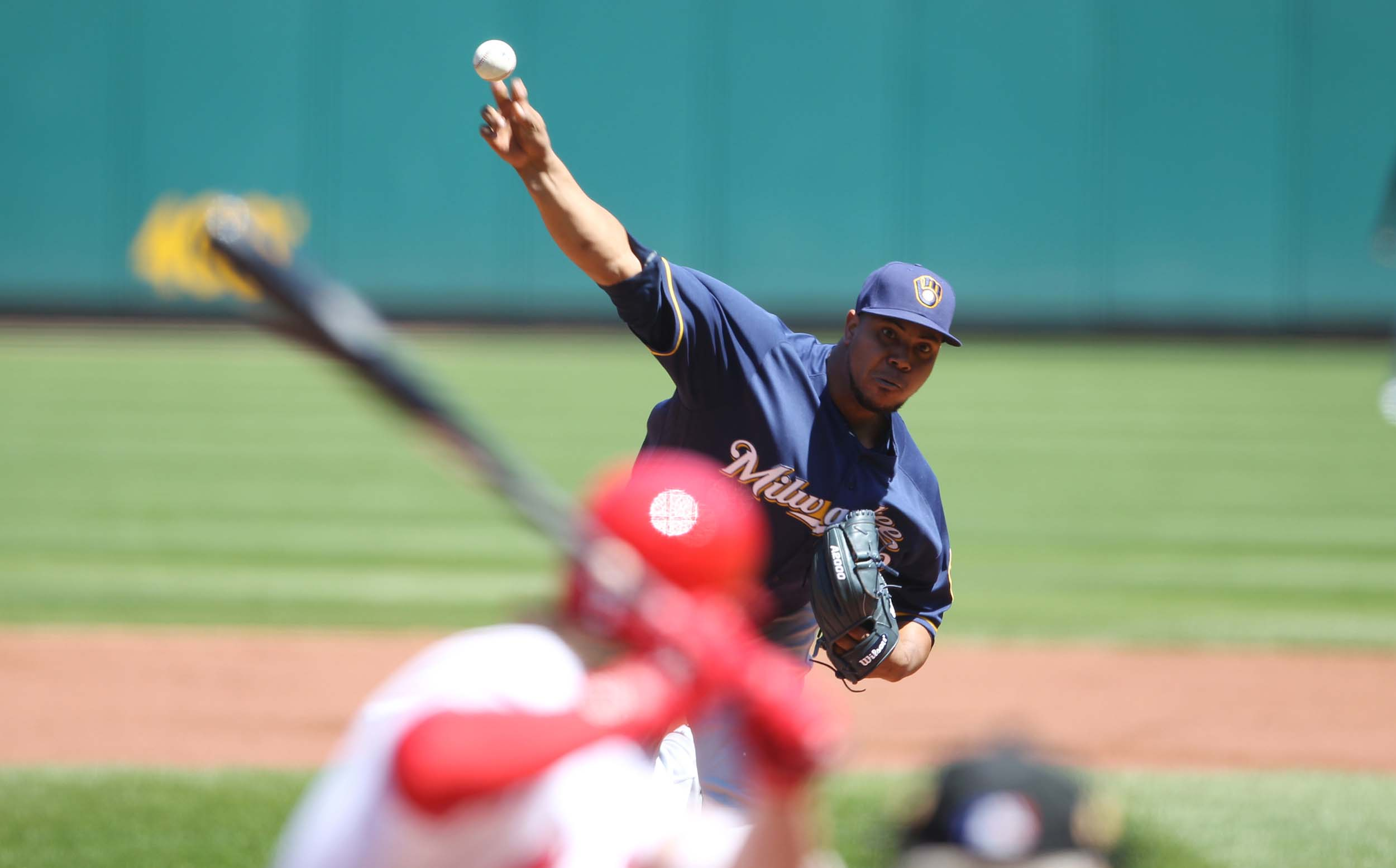 Peralta leads Brewers to first win of the season