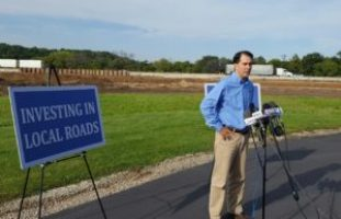 Walker warns of project delays if transportation split from budget