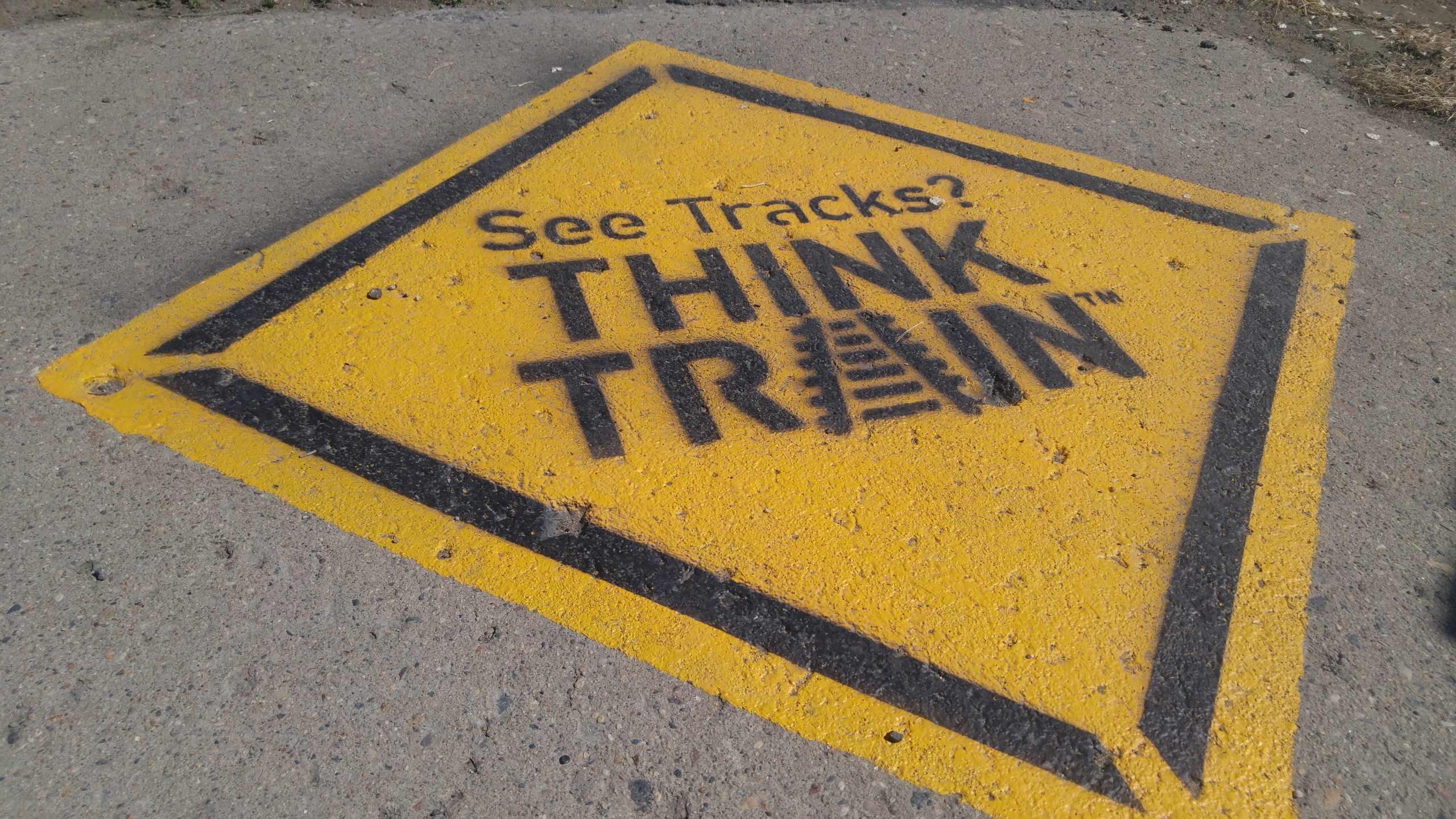 City paints sidewalks for new train safety campaign