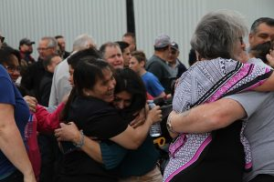 Lesi Santos (centre) is hugged as news breaks that the Santos family will be allowed to stay in Canada on June 22, 2017. (Kevin Weedmark/The World-Spectator)