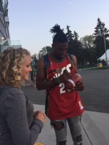 Rider Duron Carter signs the football he caught one-handed for a touchdown against the Toronto Argonauts on July 29, 2017. (Michelle Hansen/Twitter)