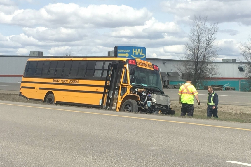Pickup truck rolls on Ring Road, school bus involved