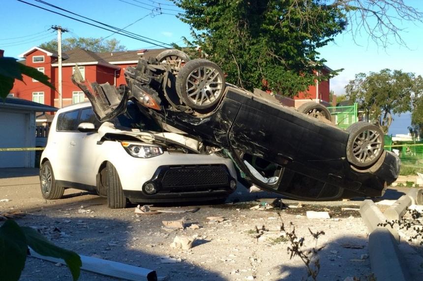Car ploughs into Saskatoon business, lands on top of parked car