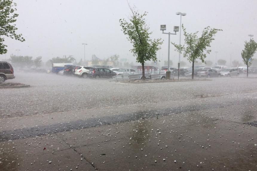 Short hailstorm leaves trail of damaged vehicles