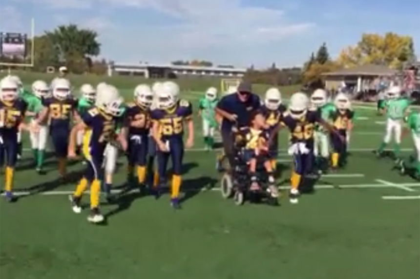 Regina boy gets touchdown in football game to remember