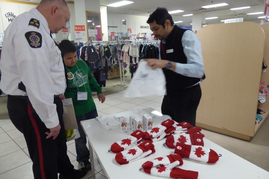 Regina police take kids on CopShop Christmas shopping spree