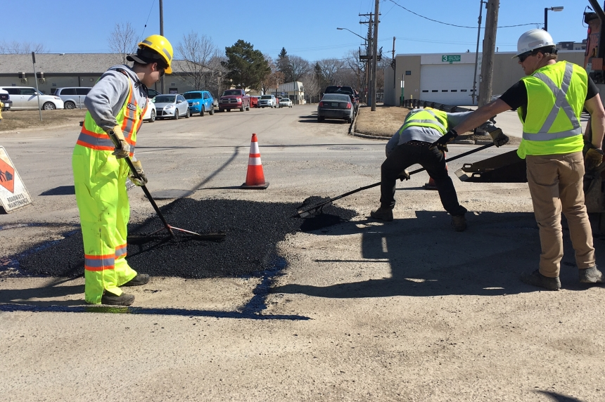 City crews out early for pothole repairs, street sweeping