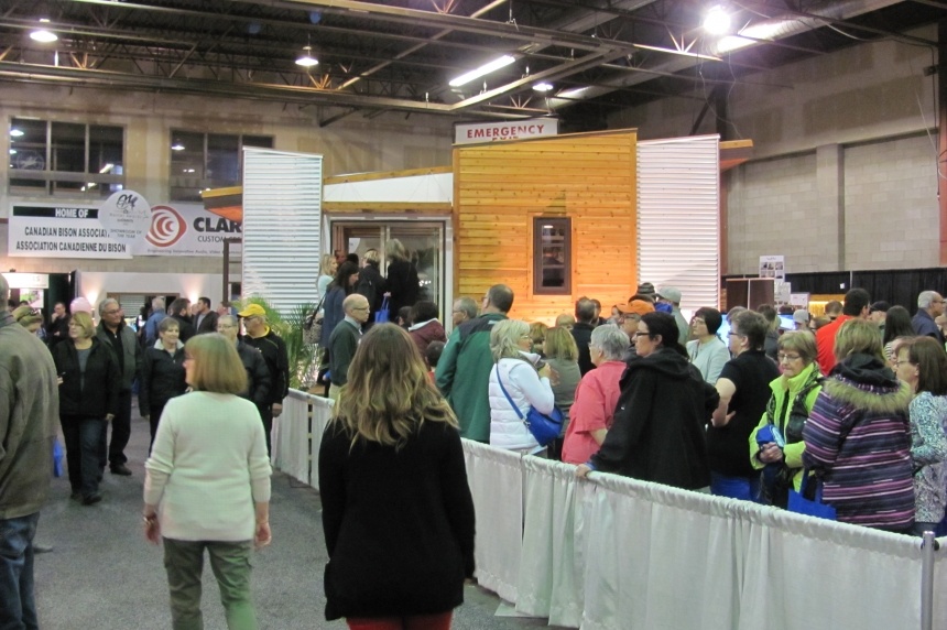 People line up to see tiny house at Regina trade show