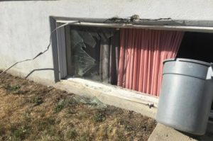 Two people were sent to hospital with minor injuries after a van crashed through their basement suite window around 8 a.m. Aug. 29, 2017. (Jessie Anton/980 CJME)