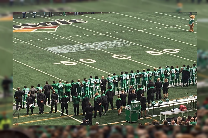 'A sign of unity:' Riders link arms during national anthem