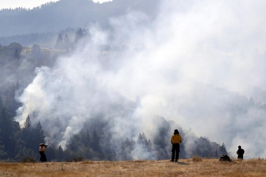 As crews gain ground, California fire victims return home