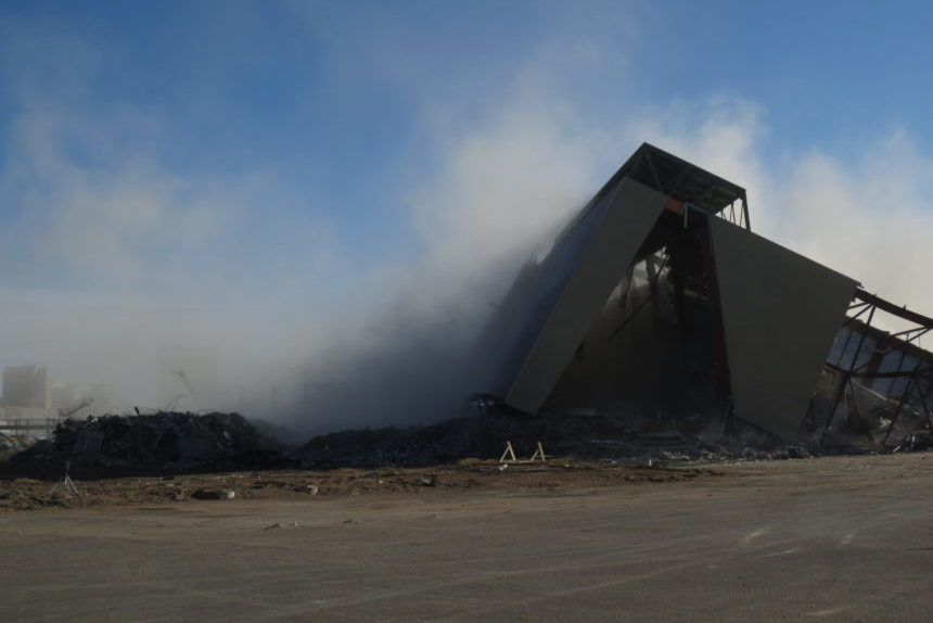 Cloud of dust moments after the controlled collapse of the west grandstand Oct. 27, 2017. (Lisa Schick/980 CJME)