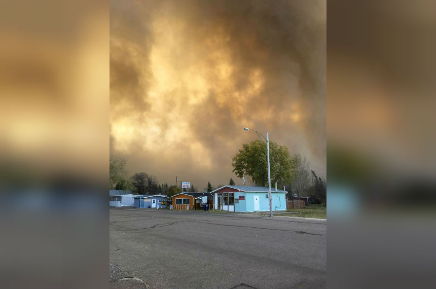 Smoke billows into the sky around the town of Burstall, Sask. as crews battle blaze in a nearby field on Oct 17, 2017. (Lou McDowell Stuebing)