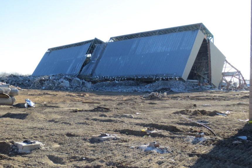 The west grandstand is on its side after a collapse on Oct. 27 2017. (Sam Maciag/980 CJME)