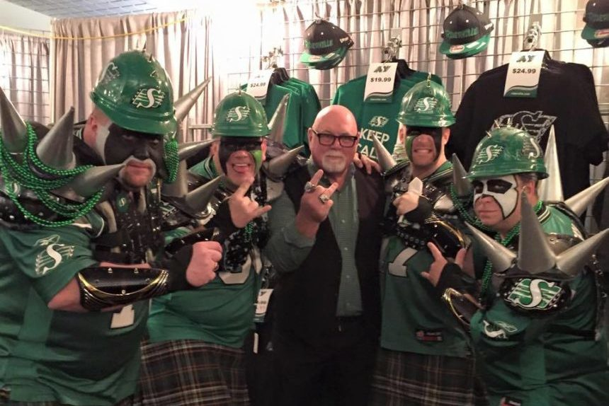 Rider Fan Todd Henrickson with his friends meeting Jim Hopson. (Submitted)