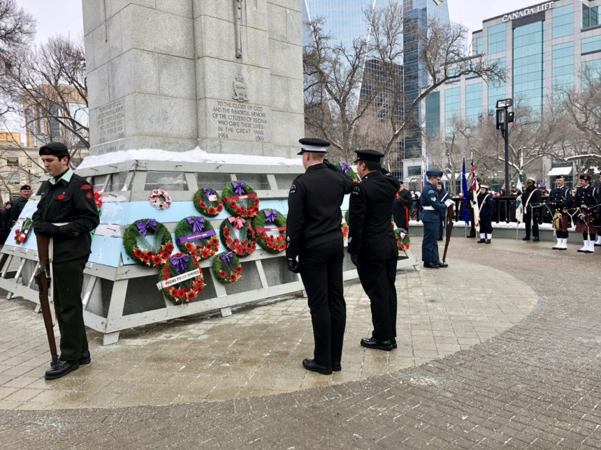 Two officers present their wreath at Regina's outdoor Remembrance Day service Nov. 11, 2017. (Jessie Anton/980 CJME)