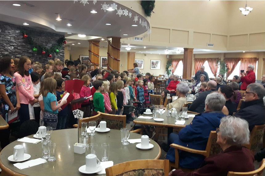 'The true spirit of Christmas:' Regina students sing carols to seniors