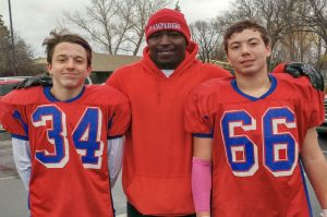 Football Preemie Lane and Parker Smaltz with coach Fred Perry
