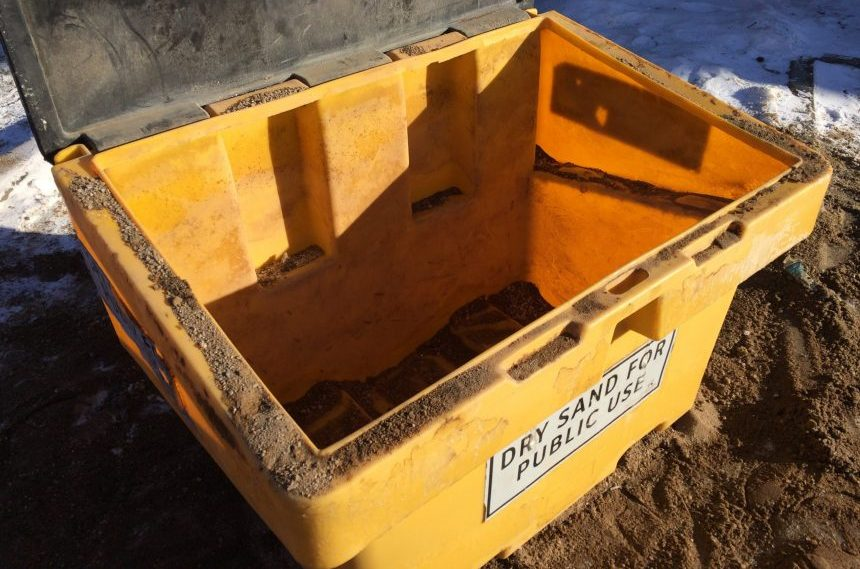 Bins of free sand for sidewalk ice control emptying quickly