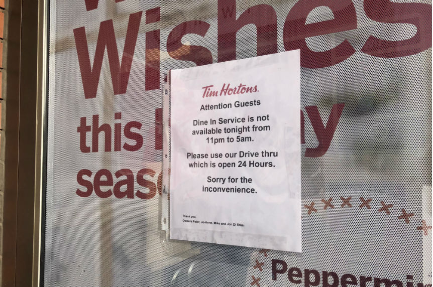 Tim Hortons on Rochdale Boulevard posted a sign stating that customers would not be able to dine-in during the night of Jan. 8, 2018. (Jessie Anton/980 CJME)