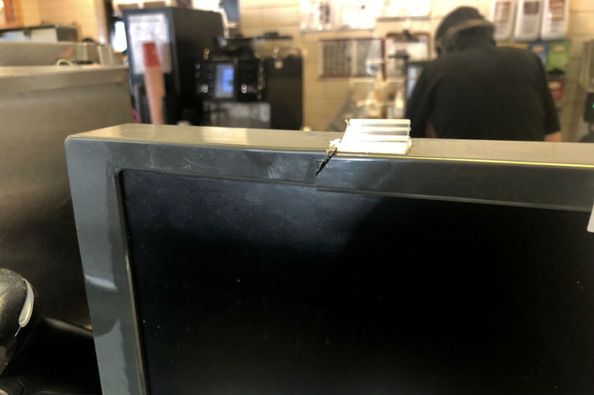 The screen of a till appears to be slashed at the Tim Hortons on Rochdale Boulevard on Jan. 8, 2018. (Jessie Anton/980 CJME)