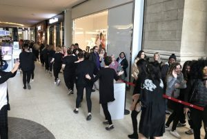 H and M Opening - staff high fiving people in line - JG - March 29 2018