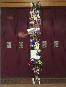 A makeshift memorial at Saskatoon's Marion Graham Collegiate for Lauren Spence, 16, who died June 9, 2017 in a car accident near Calgary.