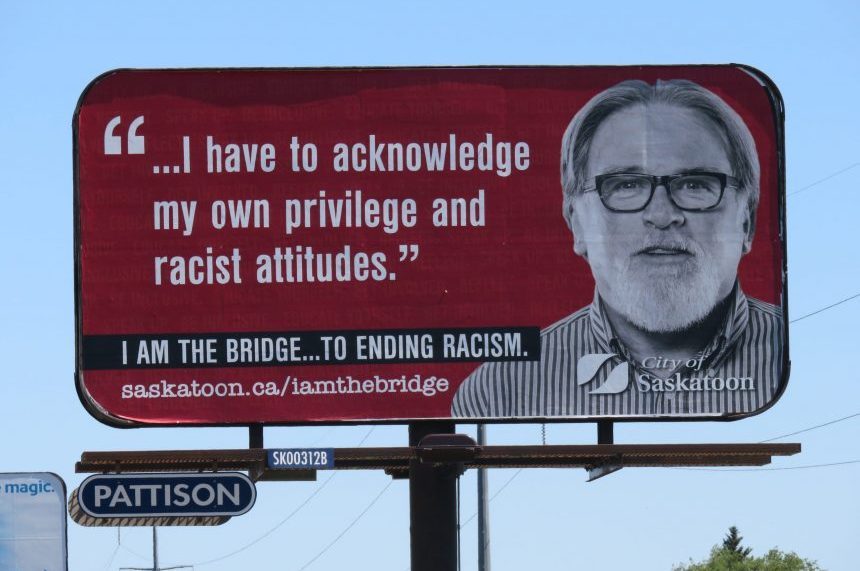 City defends anti-racism billboard over 'divisive' concerns
