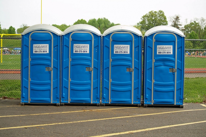 2 youth warned after tipping porta-potty with woman inside