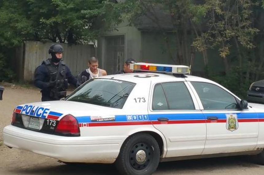 Police surround home in Saskatoon