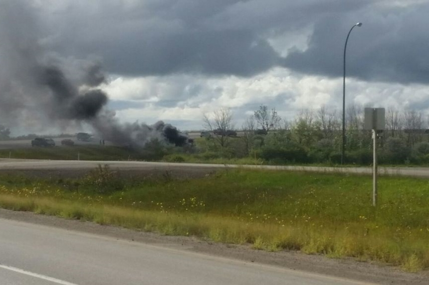 2 men taken to hospital after vehicle rolls, catches fire by Belle Plaine, Sask.