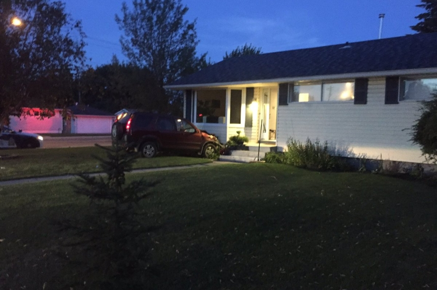 Teen driver charged after hitting parked car, home on Ruth Street