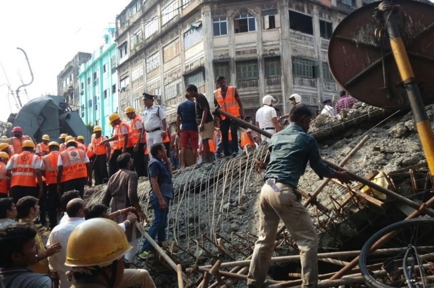 21 killed, many trapped in overpass collapse in India