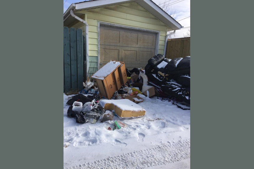 Saskatoon woman forced to pay after garbage illegally dumped in back alley