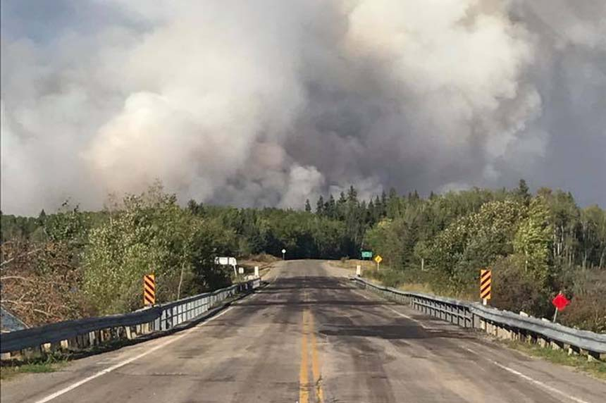 Hundreds flee as wildfires rage near Pelican Narrows