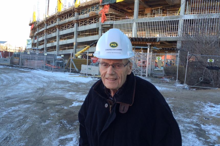 Part of the team: Regina senior keeps an eye on construction of new stadium