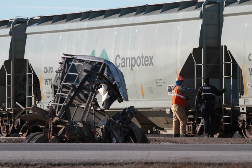 Semi's trailer destroyed in collision with train on Highway 7