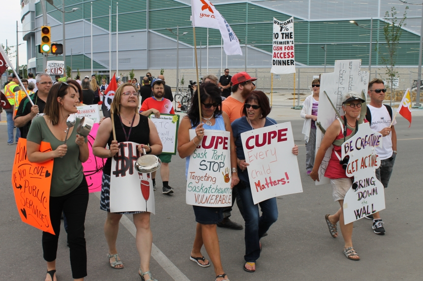 Premier interrupted but fundraiser protests relatively tame